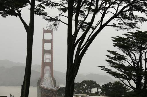 Traffic makes its way in the rain over the Golden Gate Bridge Friday, Feb. 17, 2017, in San Francisco. A powerful storm is beginning to move into California as the saturated state faces a new round of wet weather that could trigger flooding and debris flows around the northern region. (AP Photo/Eric Risberg)