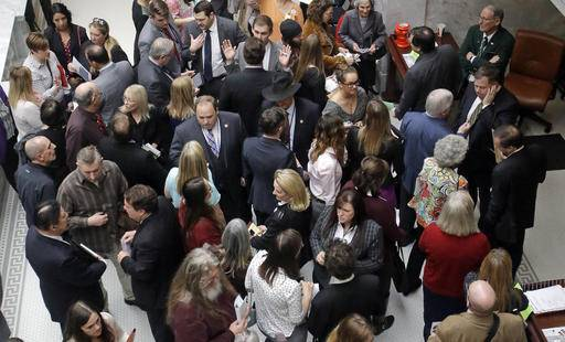 In this Thursday, Feb. 16, 2017, photo, lobbyists gather outside the Utah House of Representatives at the Utah State Capitol in Salt Lake City. Lobbyists who represent health care companies took a group of lawmakers who oversee health issues to dinner this week at an upscale restaurant in Salt Lake City. Lawmakers who attended all sit on committees that oversee health issues, but they say they were not lobbied health issues and it was a routine social event. (AP Photo/Rick Bowmer)