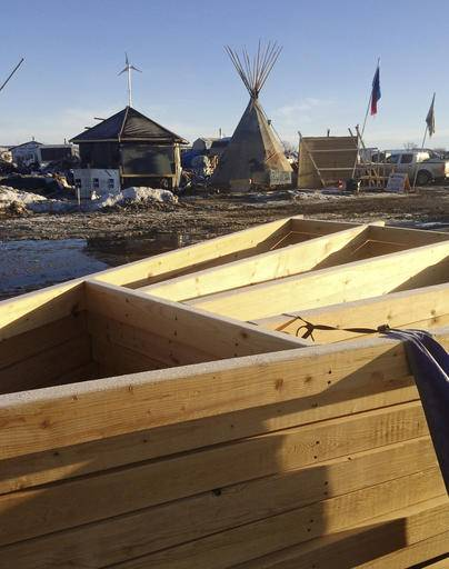 In this Thursday, Feb. 16, 2017, photo, leftover construction material is among the debris being cleaned up at the Dakota Access oil pipeline protest camp in southern North Dakota near Cannon Ball. The camp is on federal land, and authorities have told occupants to leave by Wednesday, Feb. 22, in advance of spring flooding. (AP Photo/Blake Nicholson)