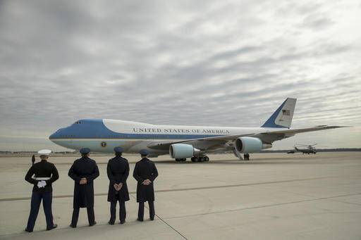 Military personnel watch as Air Force One, with President Donald Trump, aboard prepares to depart at Andrews Air Force Base in Md., Friday, Feb. 17, 2017. Trump is visiting Boeing South Carolina to see the Boeing 787 Dreamliner before heading to his estate Mar-a-Lago in Palm Beach, Fla., for the weekend. (AP Photo/Andrew Harnik)