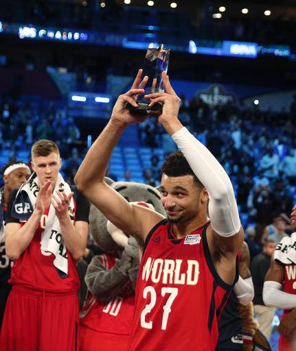 World guard Jamal Murray (27) of the Denver Nuggets holds up his MVP trophy after the Rising Stars Challenge, part of NBA All-Star events in New Orleans, Friday, Feb. 17, 2017. (AP Photo/Gerald Herbert)