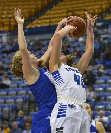 Drake's Brenni Rose, left, blocks a shot attempt from Indiana State's Rhagen Smith during an NCAA college basketball game Friday, Feb. 17, 2017, in Terre Haute, Ind. (Austen Leake/Tribune-Star via AP)