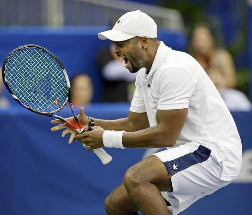 Donald Young, of the United States, celebrates after defeating countryman John Isner in a quarterfinal at the Memphis Open tennis tournament Friday, Feb. 17, 2017, in Memphis, Tenn. (AP Photo/Mark Humphrey)