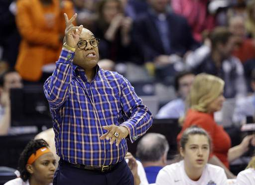 FILE- In this April 5, 2016, file photo, Syracuse head coach Quentin Hillsman gestures on the sidelines during the second half of the championship game against Connecticut at the women's Final Four in the NCAA college basketball tournament in Indianapolis. When Hillsman makes out his lineup, he smiles every time he writes the names of Alexis Peterson and Brittney Sykes.