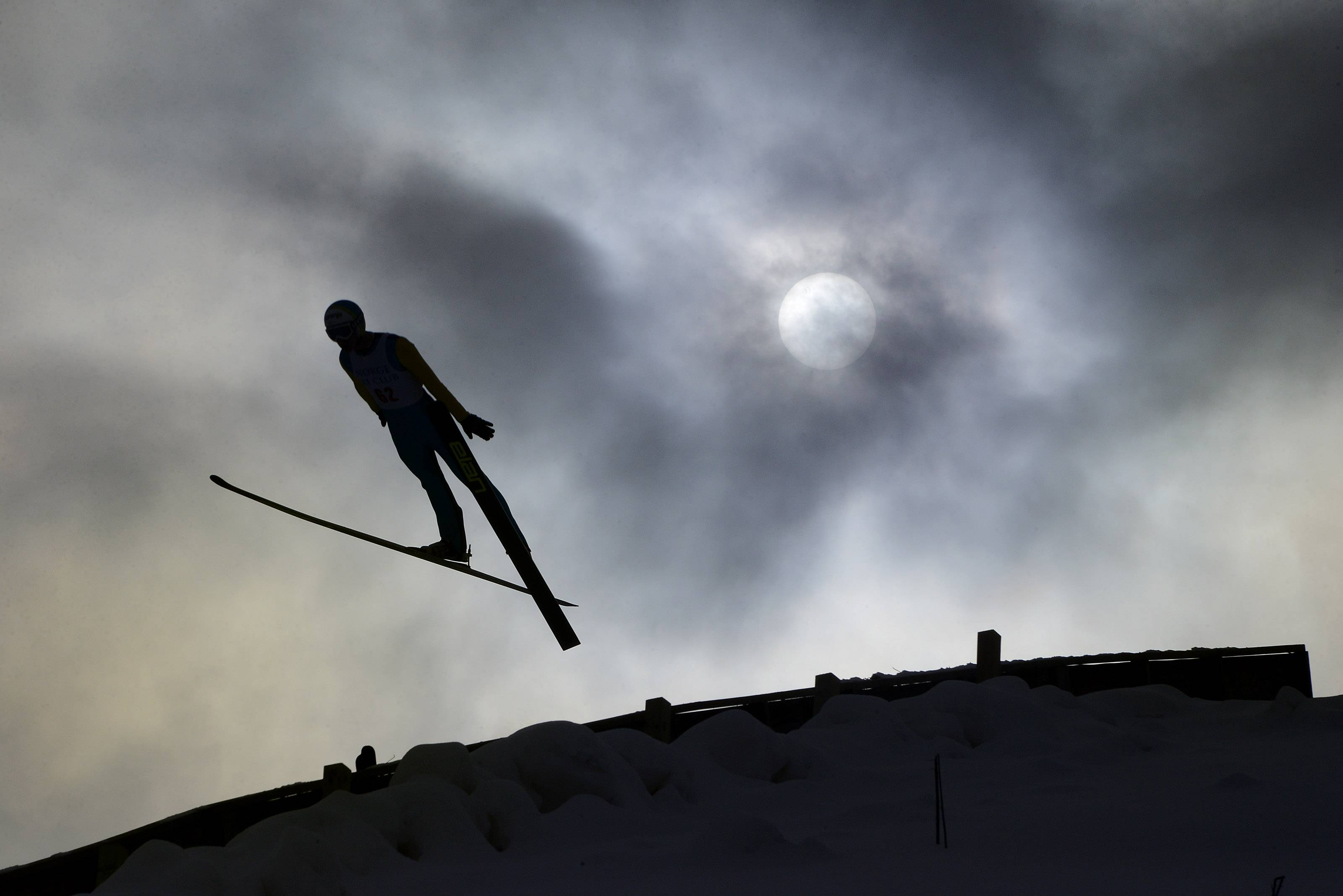 The snow was fake but the thrills were real for ski jumpers like this one at the Norge International Ski Jumping Tournament in Fox River Grove.