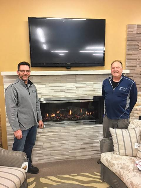 Northwest Metalcraft owner Daniel Mayer, left, and installer Scott Selleck show a new Mendota linear gas fireplace with a stacked stone front that offers a contemporary look.