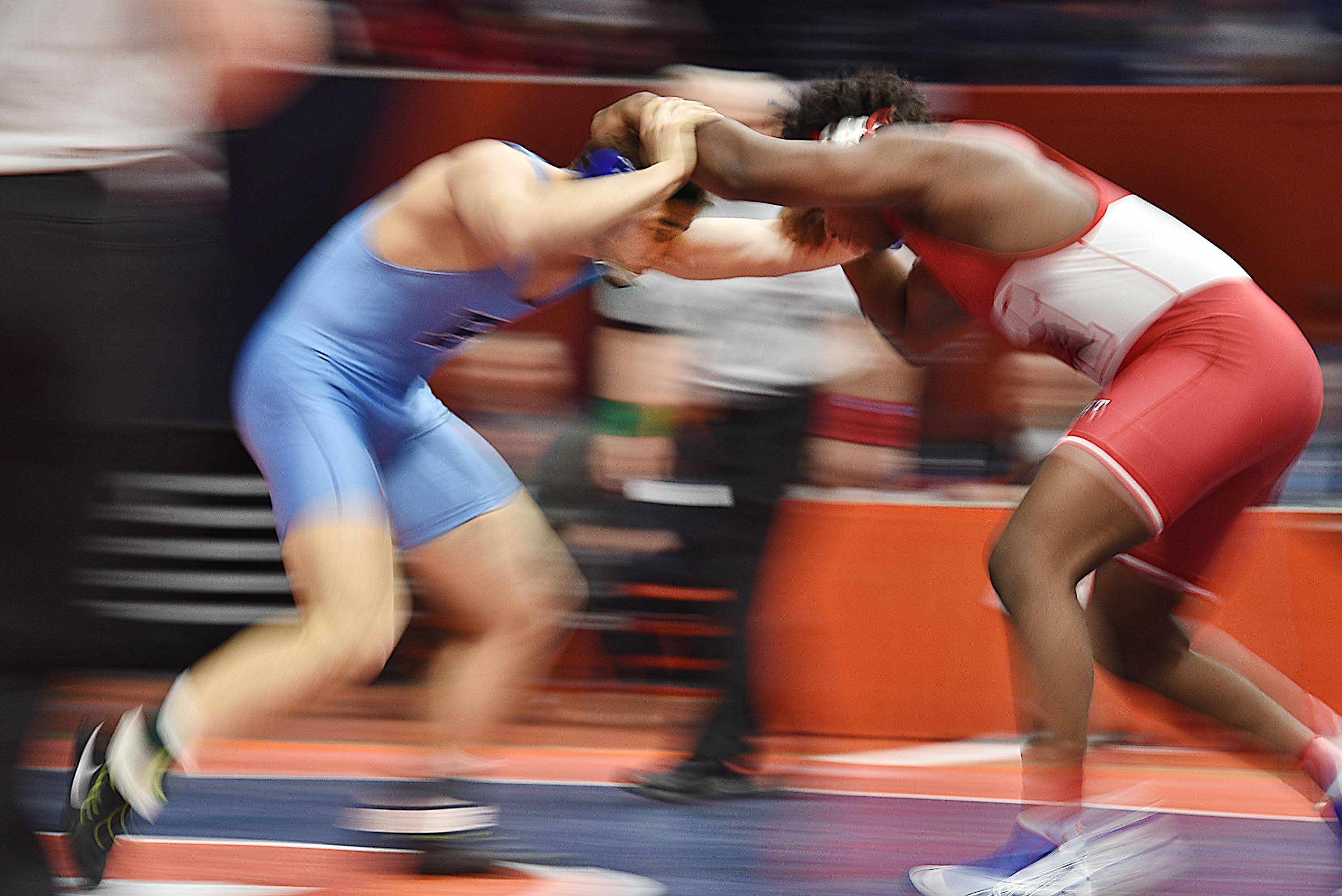 Prospect's Matt Wroblewski and Marist's Diata Drayton scramble for position Saturday in the Class 3A state championship 220-pound bout during the wrestling state final in Champaign. Wroblewski, a senior, won 8-4.