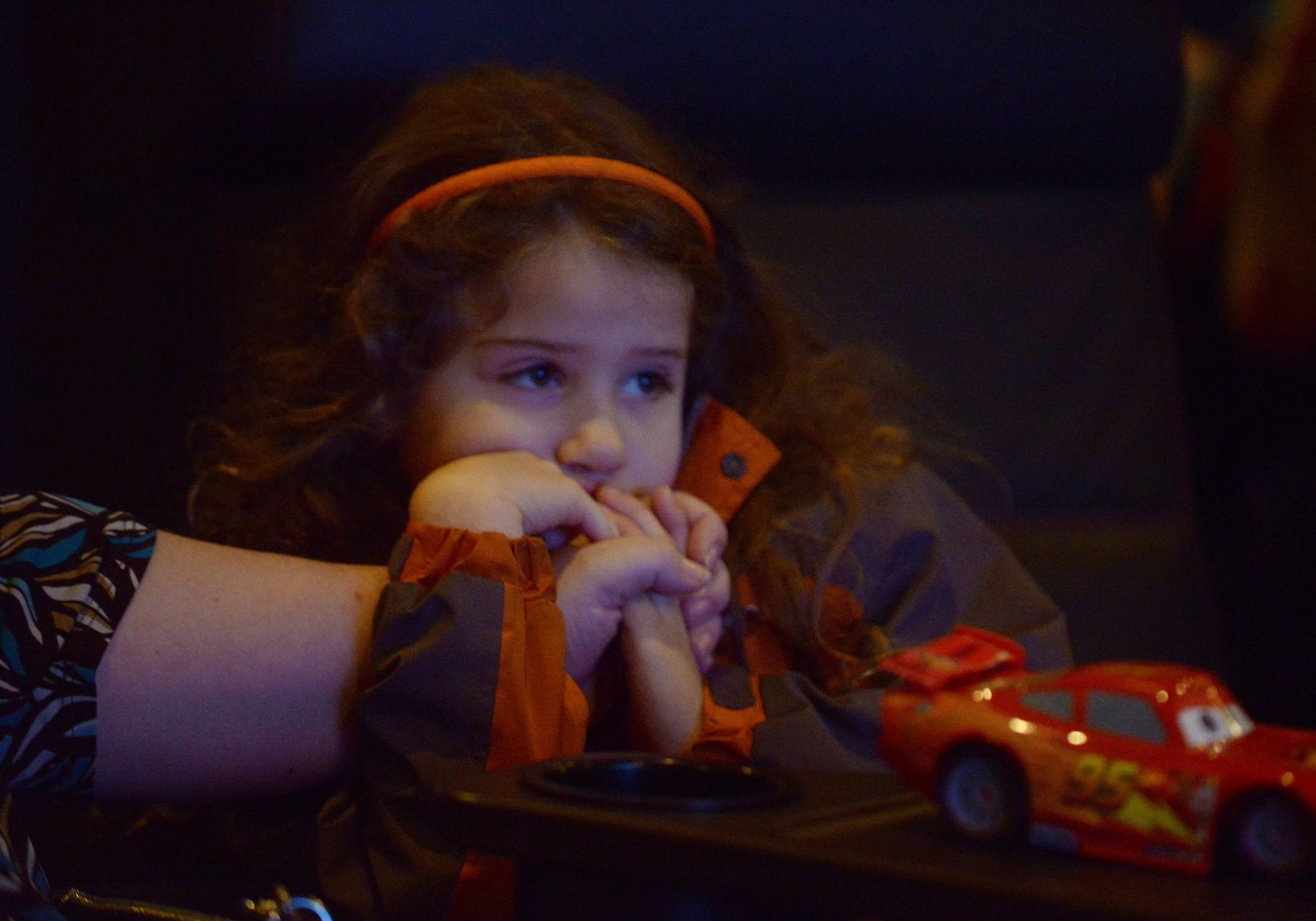 "Mariela Sewell, 5½, of Des Plaines watches a sensory-friendly version of ""The Lego Batman Movie"" with her mom, Dawn Augustyn, at the Paragon Theater in Arlington Heights. Many suburban movie theaters offer sensory-friendly films for children with autism and other disorders."
