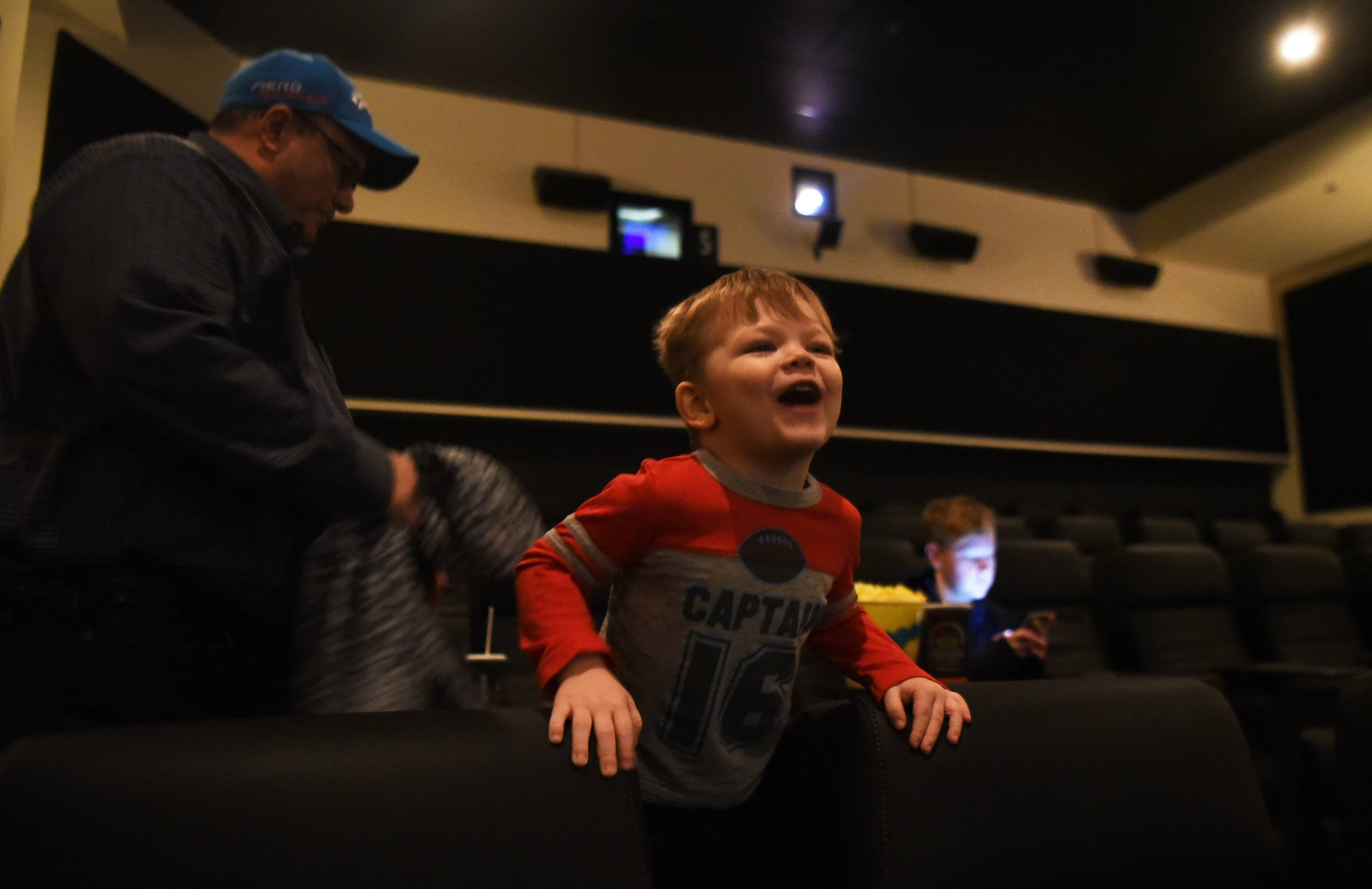 Jacob Lichner, 3, of Arlington Heights, attends a sensory-friendly movie with his dad, Kirk, and brother, A.J, at the Paragon Theater in Arlington Heights.