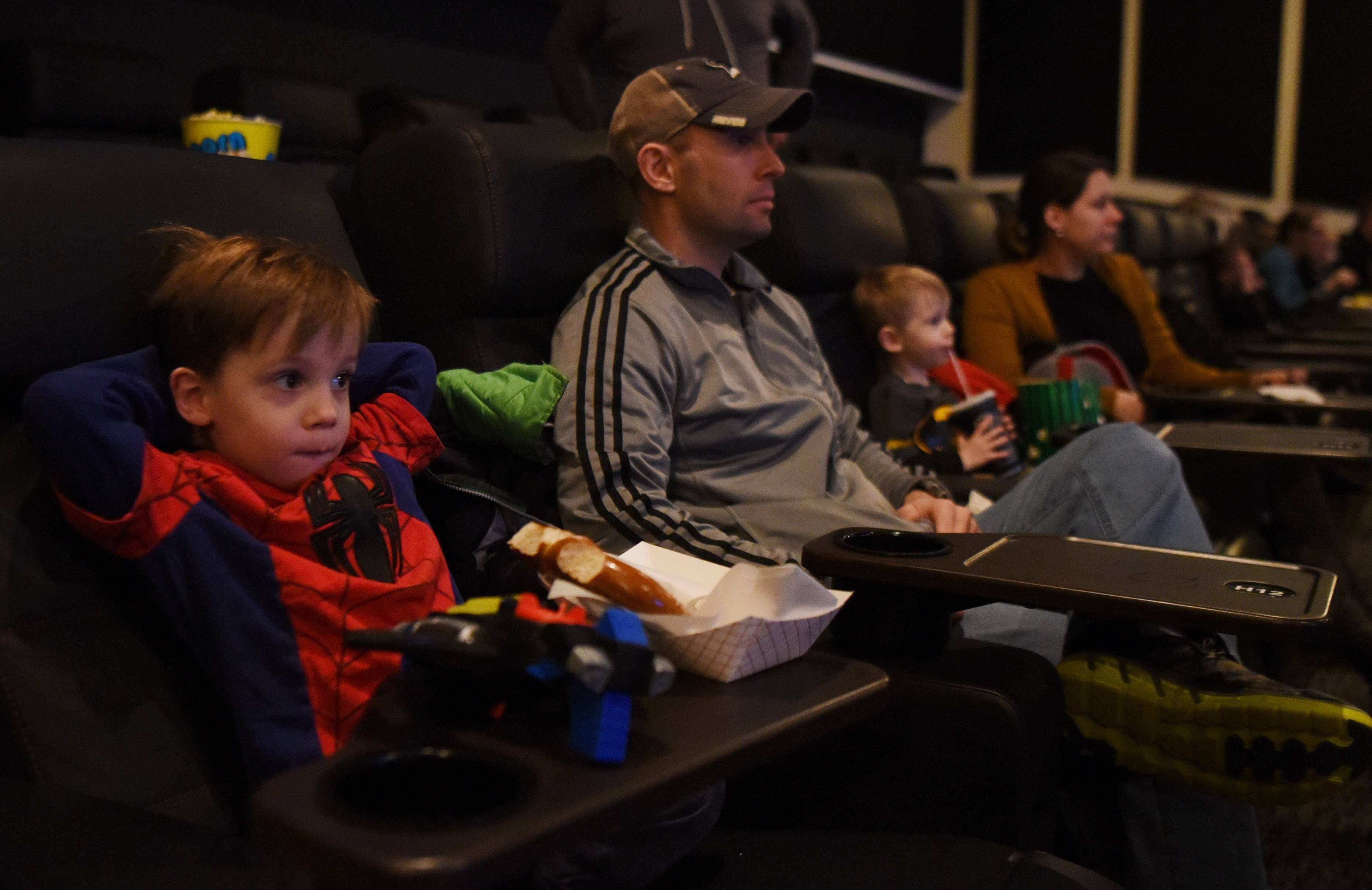 "Ethan Eichstaedt, 5, of Arlington Heights watches a movie with his dad, Scott, his brother, Blaine, 2, and mom, Amanda, during a sensory-friendly version of ""The Lego Batman Movie"" at the Paragon Theater in Arlington Heights."