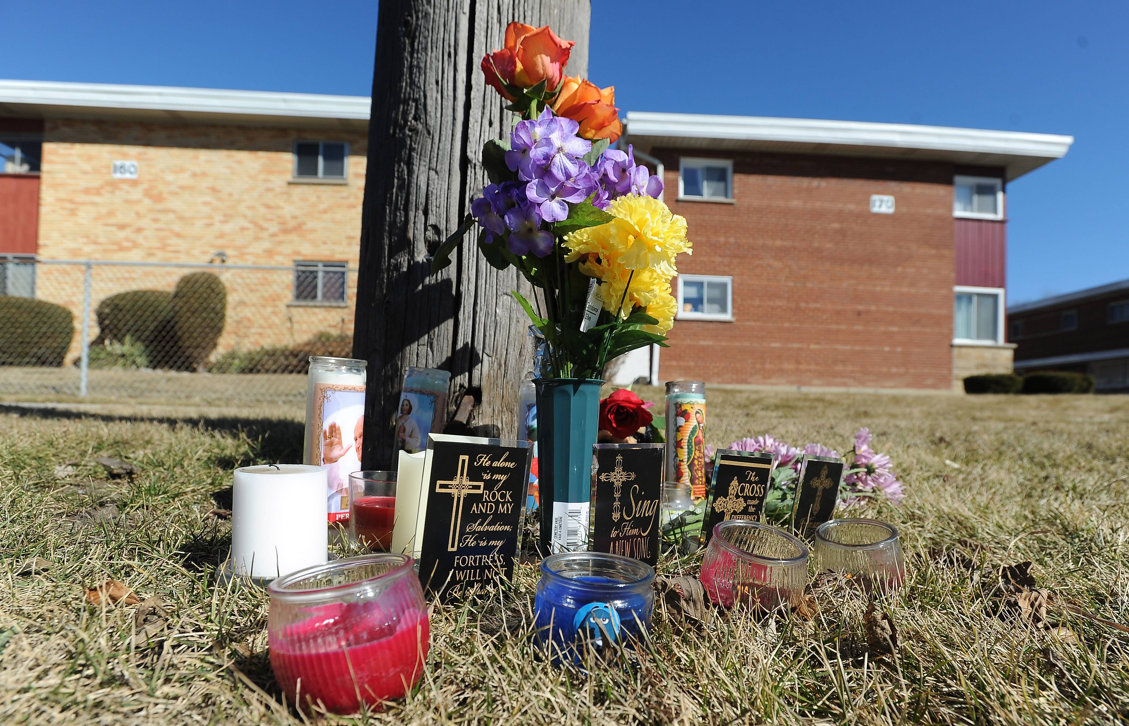Mourners have created a memorial to the Crawfords along Northwest Highway in Des Plaines.