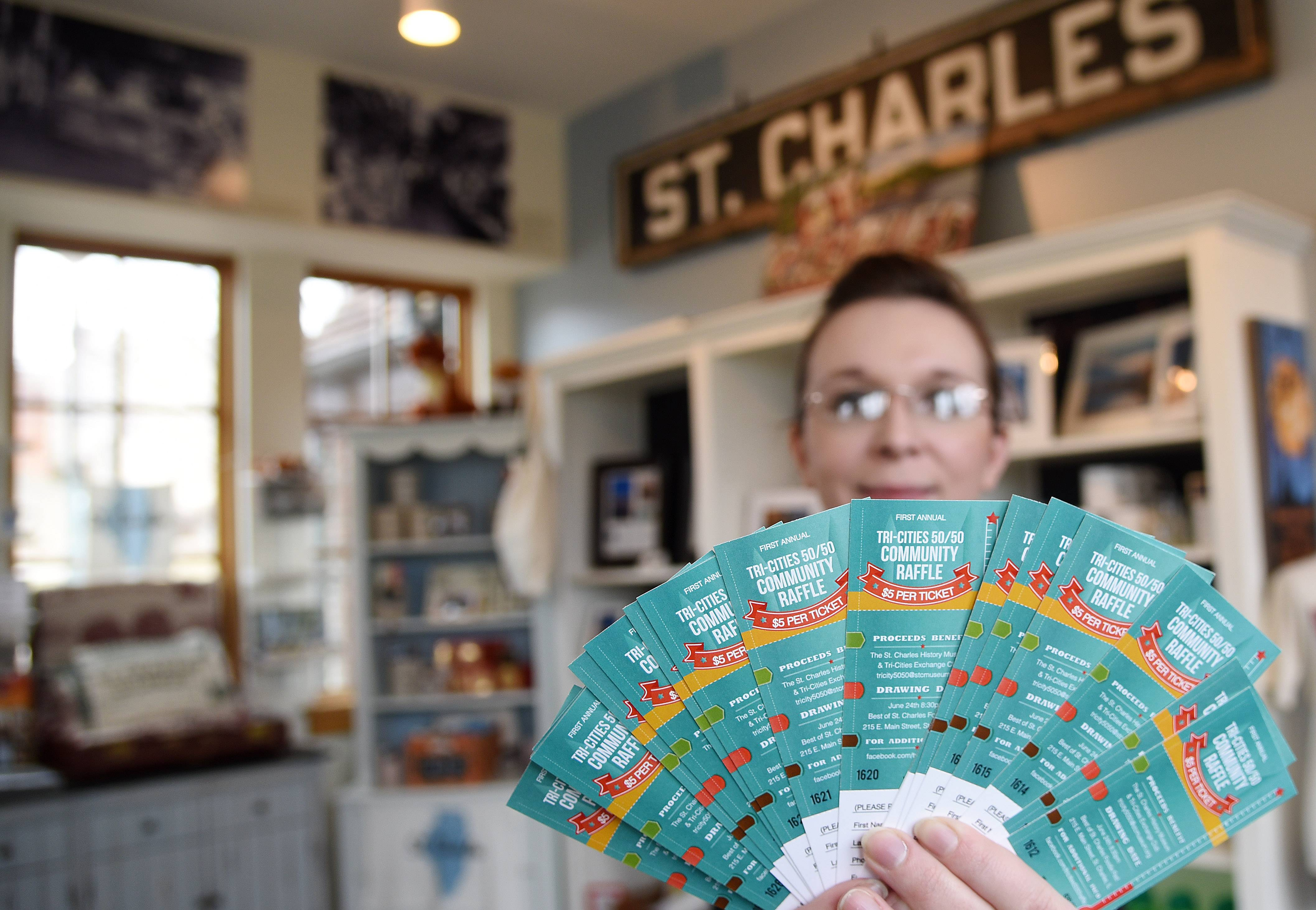 Alison Costanzo, executive director of the St. Charles History Museum, holds tickets for this year's 50-50 raffle. They're hoping to sell 8,000 tickets at $5 a piece, leaving a $40,000 prize to split.