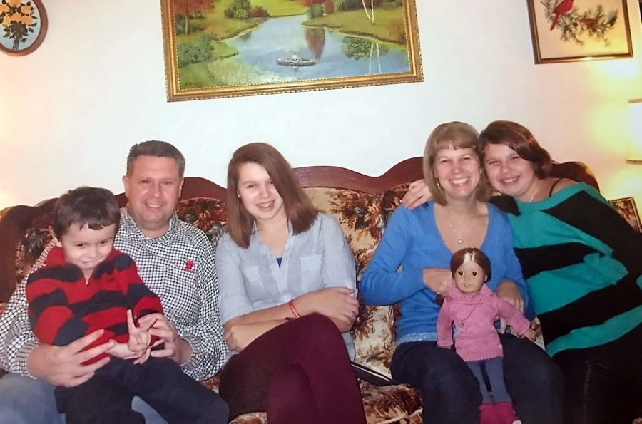 A family photo shows the Crawfords -- from left, Christian, Kevin, Kirsten, Anita and Hailee.