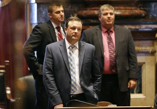 "FILE - In this Thursday, May 1, 2014, file photo, Iowa Senate Minority Leader Bill Dix, R-Shell Rock, center, looks on as Iowa Senate Majority Leader Michael Gronstal speaks on the floor of the Senate at the Statehouse in Des Moines, Iowa. After decades as the crossroads of prairie populists and checkbook conservatives, Iowa has suddenly become solidly Republican like many of its Midwestern neighbors. To act cautiously in light of November's heavy Republican legislative victories could hurt the GOP's chances of holding its majority, so it's all or nothing, Dix said. ""That's what our mandate is, and to me it's not one that's very patient.�"