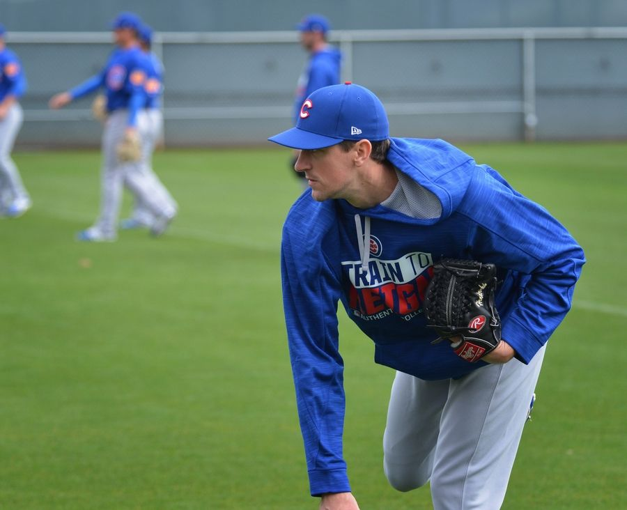 Chicago Cubs starting pitcher Kyle Hendricks following through on a throw at Spring training.