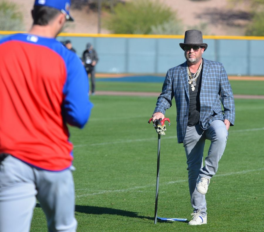 Cubs strength and conditioning coach Tim Buss dressed up with a top hat, some chains for bling and a walking stick to add some fun to Monday's workout.