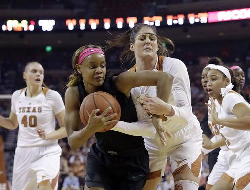 Baylor forward Nina Davis, left, and Texas forward Audrey-Ann Caron-Goudreau, right, battle for control of the ball during the first half of an NCAA college basketball game, Monday, Feb. 20, 2017, in Austin, Texas. (AP Photo/Eric Gay)