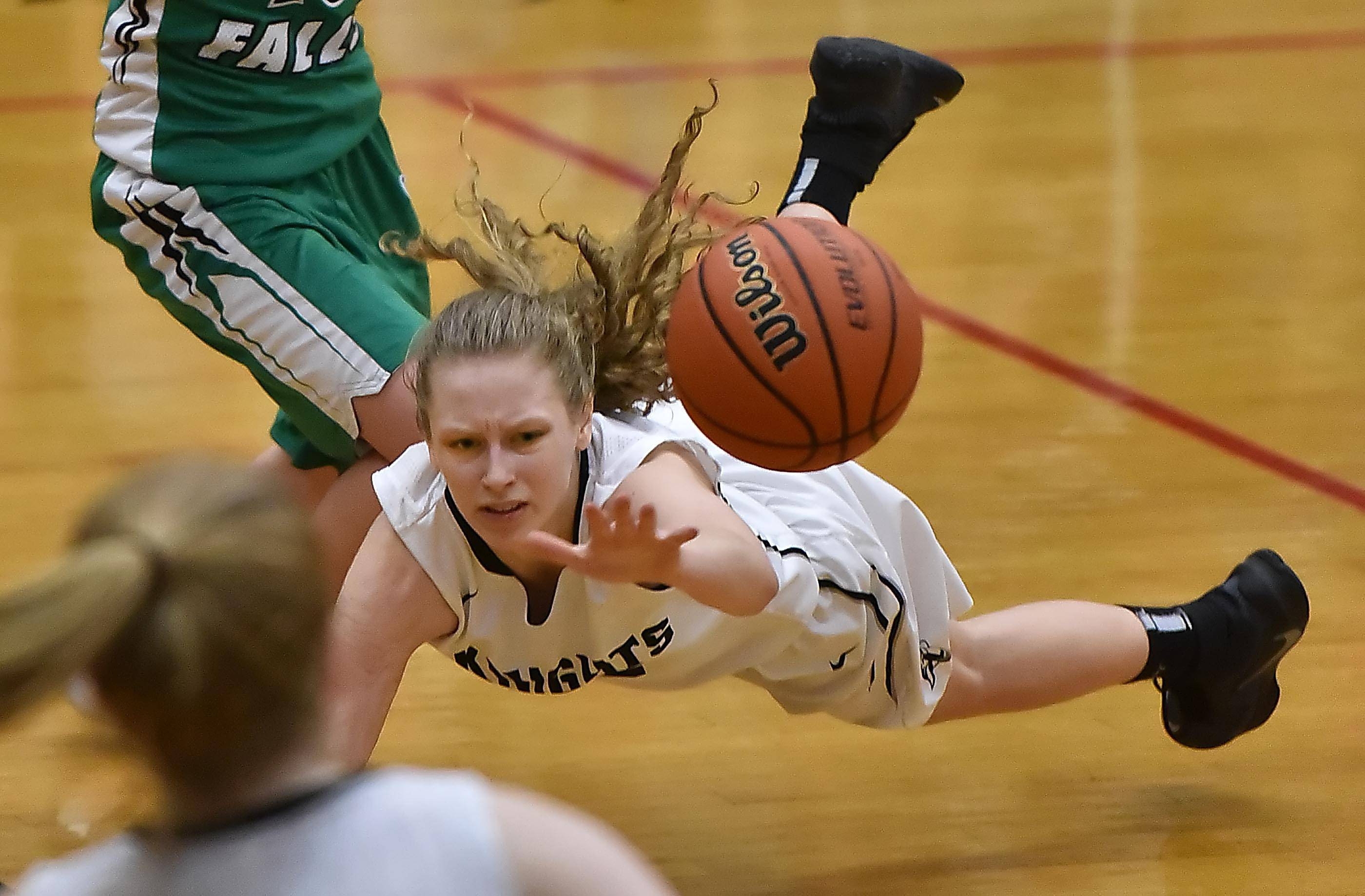Kaneland's Jamie Martens dives for the ball against Rock Falls in the Class 3A girls basketball sectional semifinal game Tuesday in Maple Park.