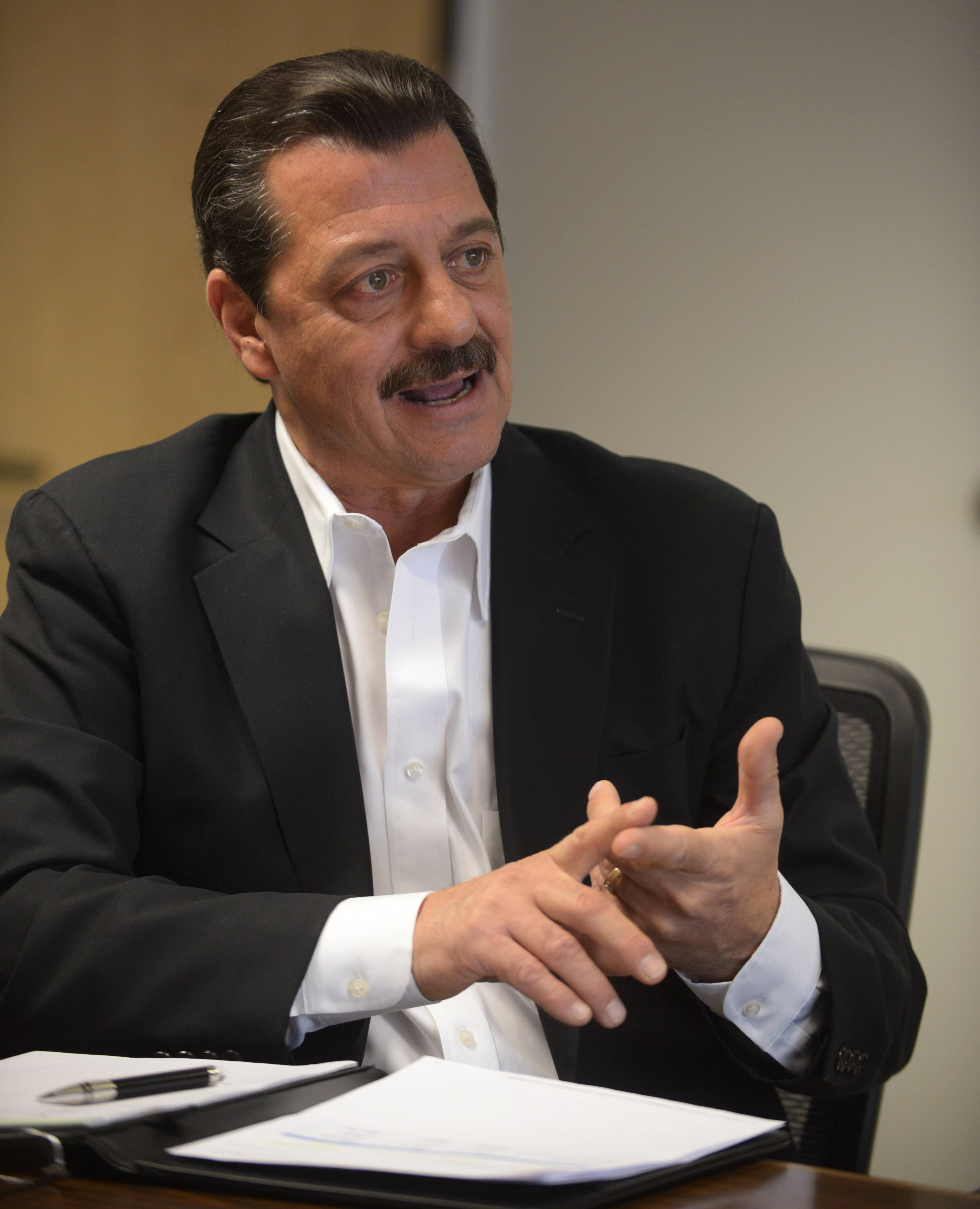 Wheeling Village President Dean Argiris speaks during an interview with the Daily Herald.