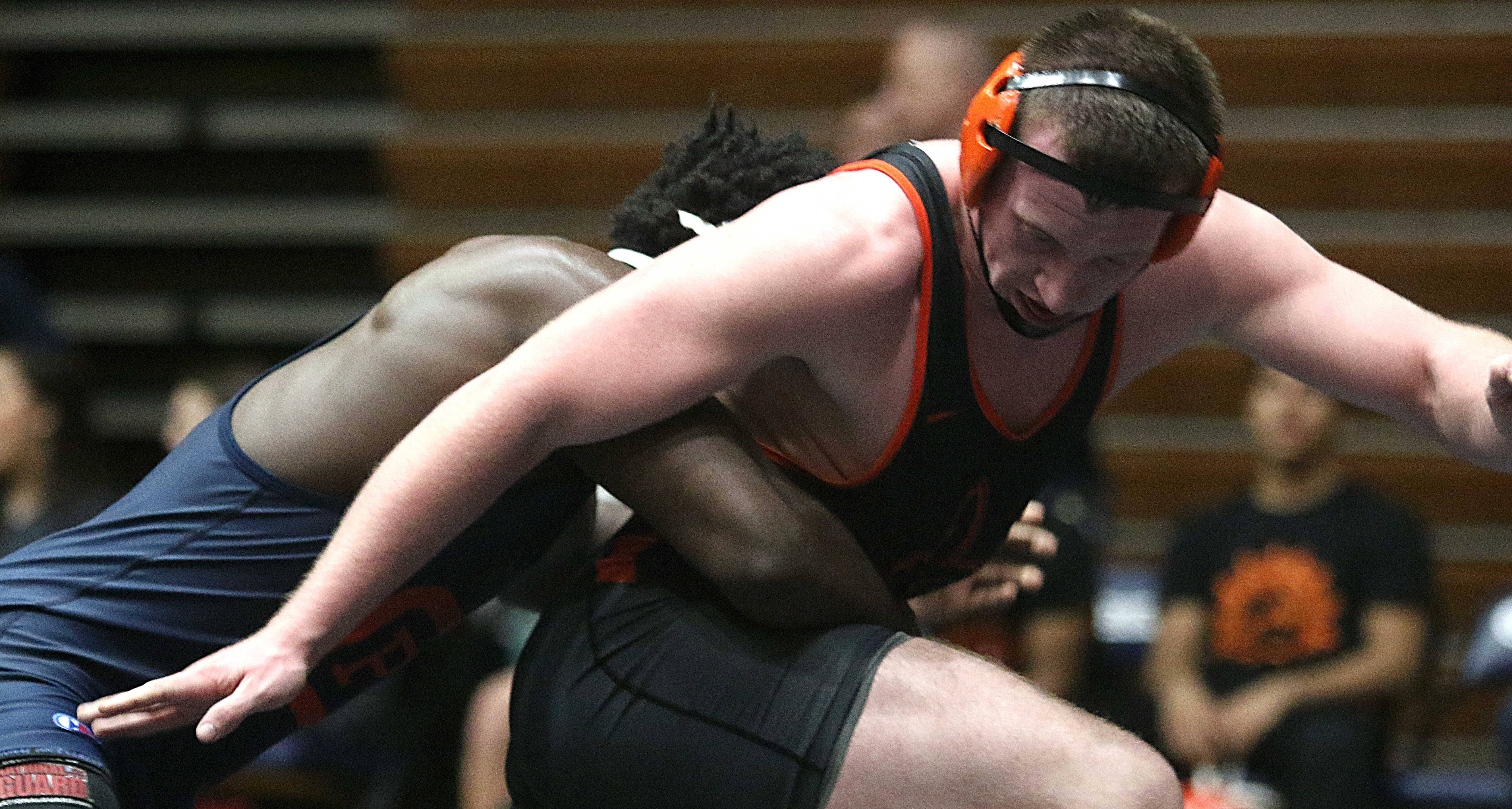 St. Charles East's Cody Glidewell, front, evades Oak Park-River Forest's Tariq Thurman at 182 pounds during team wrestling sectional action at William N. Perry Gymnasium at Conant on Tuesday.