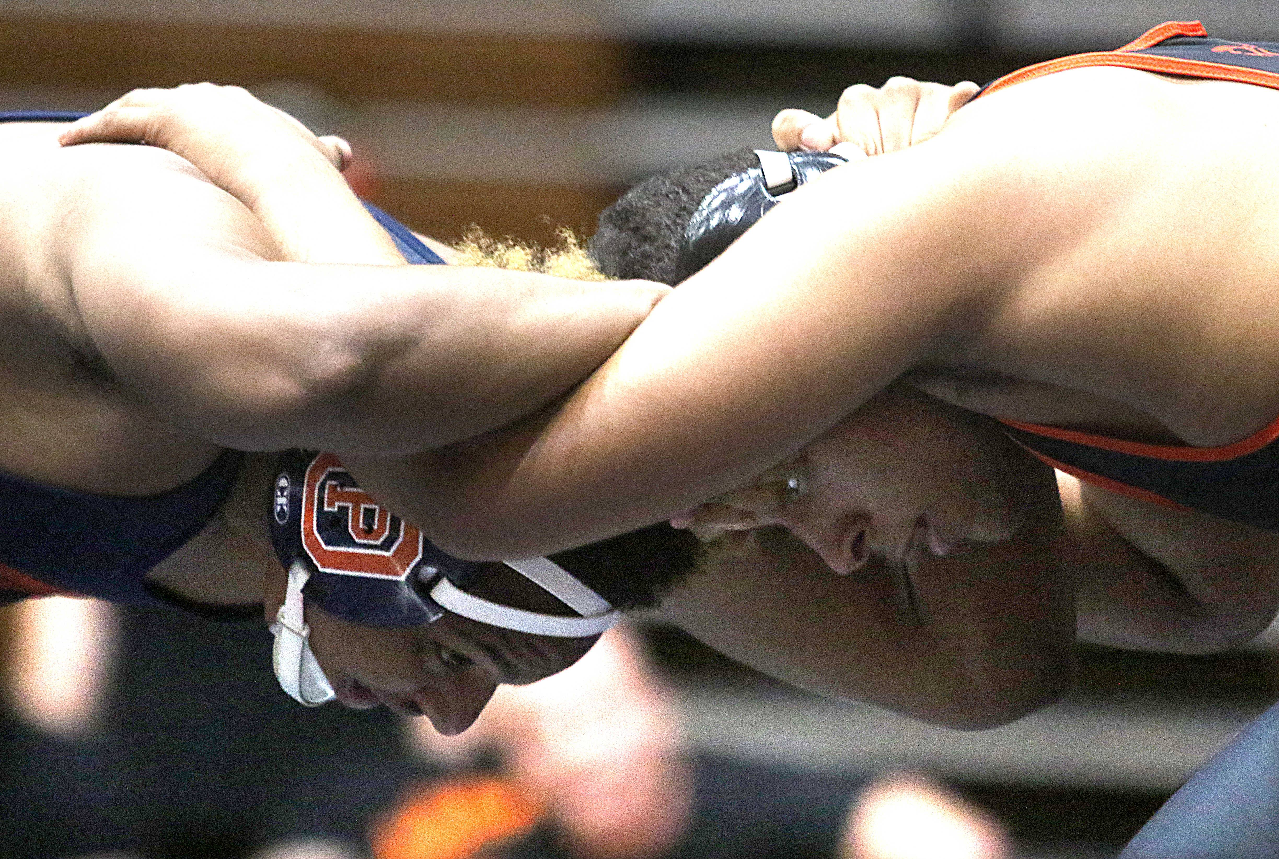 St. Charles East's Darrell Gregg, right, gets tied up with Oak Park-River Forest's Elijah Osit at 195 pounds during team wrestling sectional action at William N. Perry Gymnasium at Conant on Tuesday.