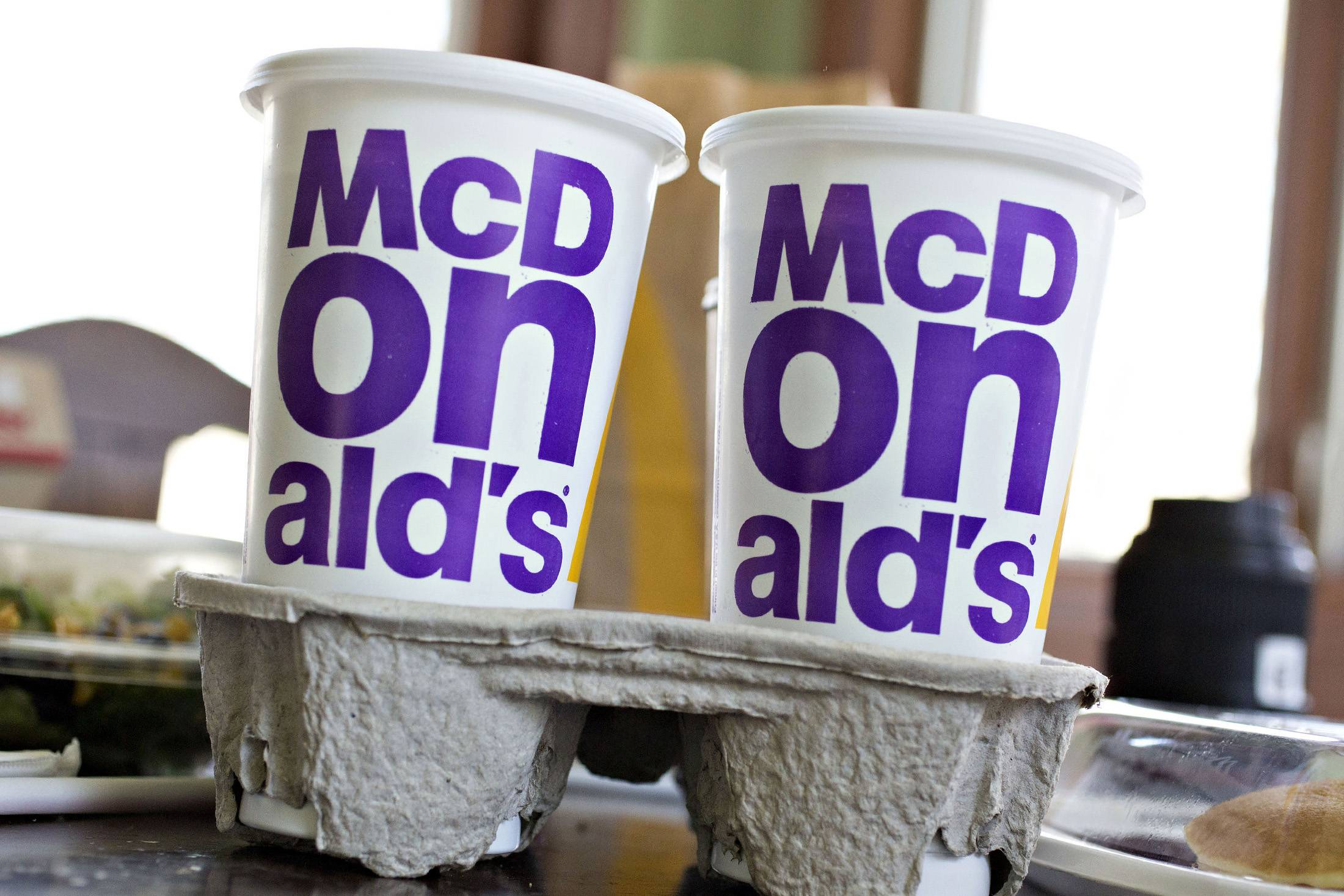 McDonald's plans to offer $1 sodas and $2 McCafe specialty drinks across the U.S. It's turning to higher-margin beverages at a time when cheap grocery prices are prodding more Americans to eat at home.