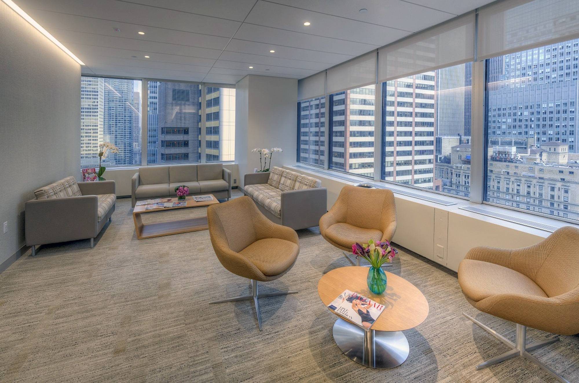 Sunlight streams in to a serene, calming waiting space overlooking midtown New York's bustling cityscape, at the Colorado Center for Reproductive Medicine's New York offices.