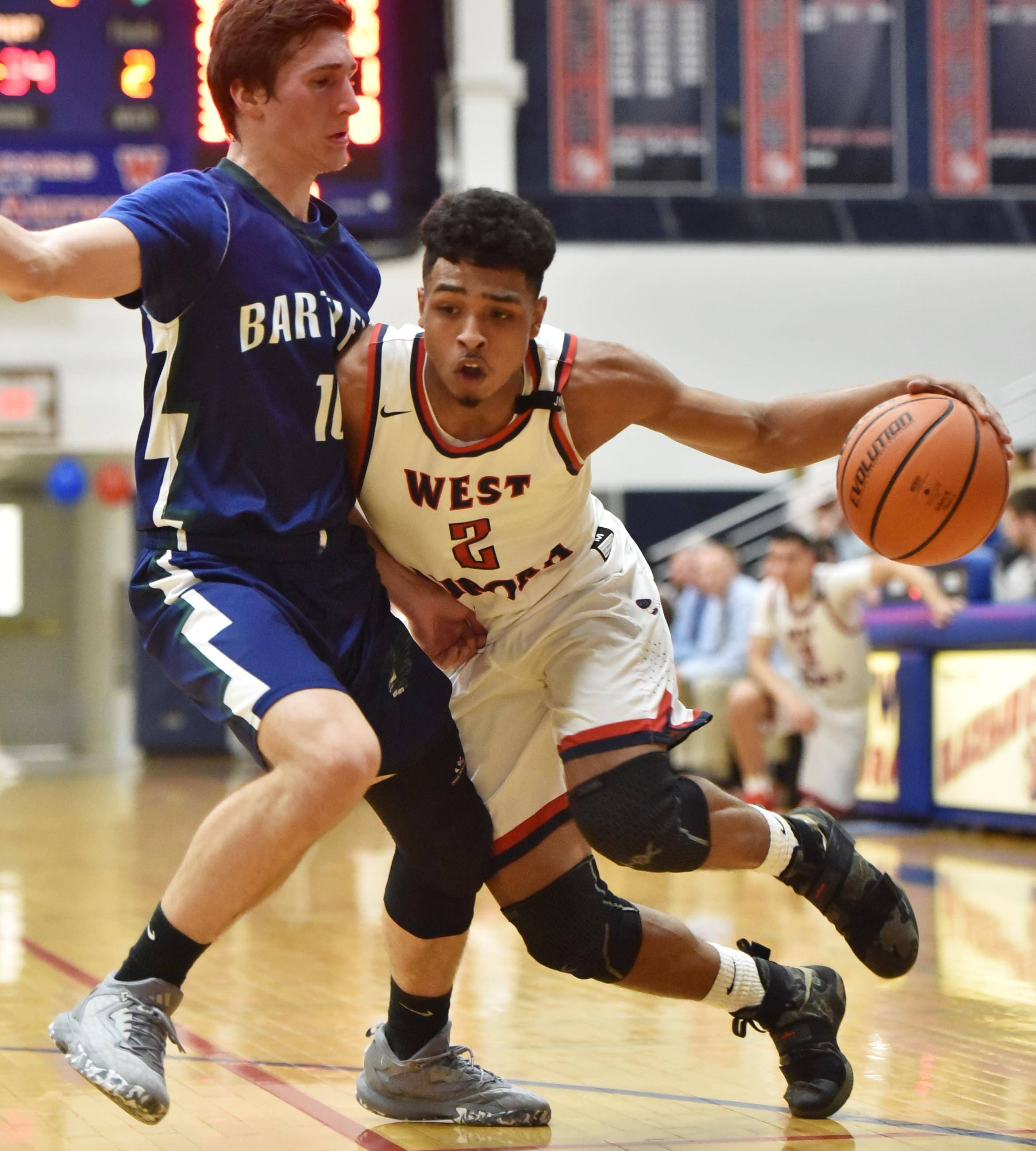 West Aurora's Camron Donatlan tries to drive around Bartlett's Tomas Vikonis Wednesday in Aurora.