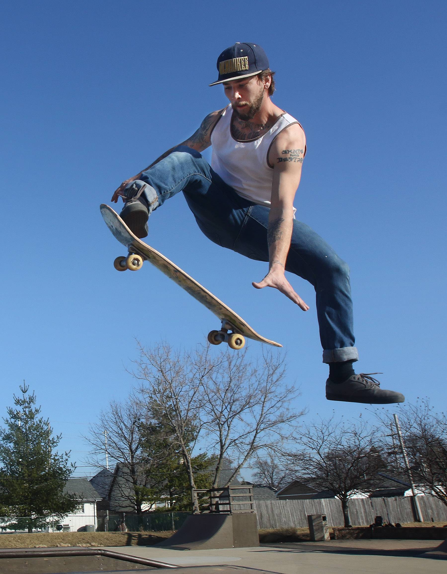 Codey Walsh of Lake Villa flies high with his skateboard Wednesday afternoon at Daniel Barry Memorial Skate Park in Grayslake. The unusually warm weather in February continued for another day, giving people a taste of Spring.