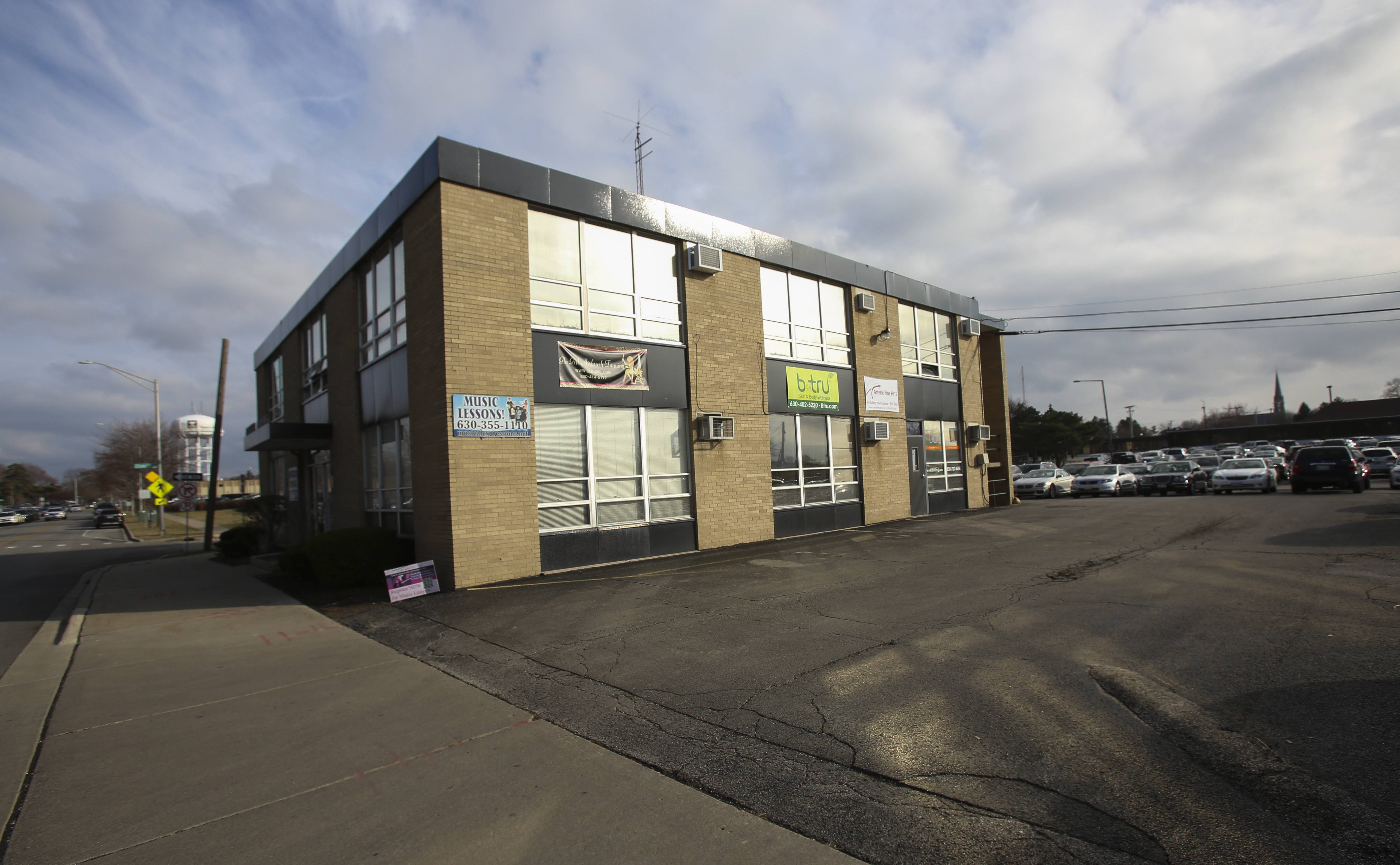 Naperville City Council will issue a request for qualifications to gather redevelopment ideas for several city-owned properties near the 5th Avenue Metra station, including this building housing businesses at 190 E. 5th Avenue.