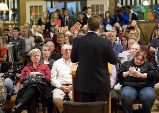 Congressman Dave Brat, R-Va., back to camera, answers questions during a town hall meeting with the congressman in Blackstone, Va., Tuesday, Feb. 21, 2017.
