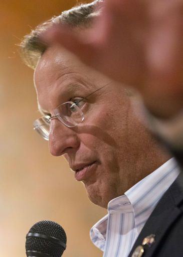Congressman Dave Brat, R-Va., gestures as he answers questions during a town hall meeting with the congressman in Blackstone, Va., Tuesday, Feb. 21, 2017.