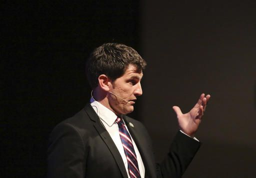 Congressman Scott Taylor answers a question during a town hall meeting in Yorktown, Va., Tuesday, Feb. 21, 2017. (Steve Earley/The Virginian-Pilot via AP)