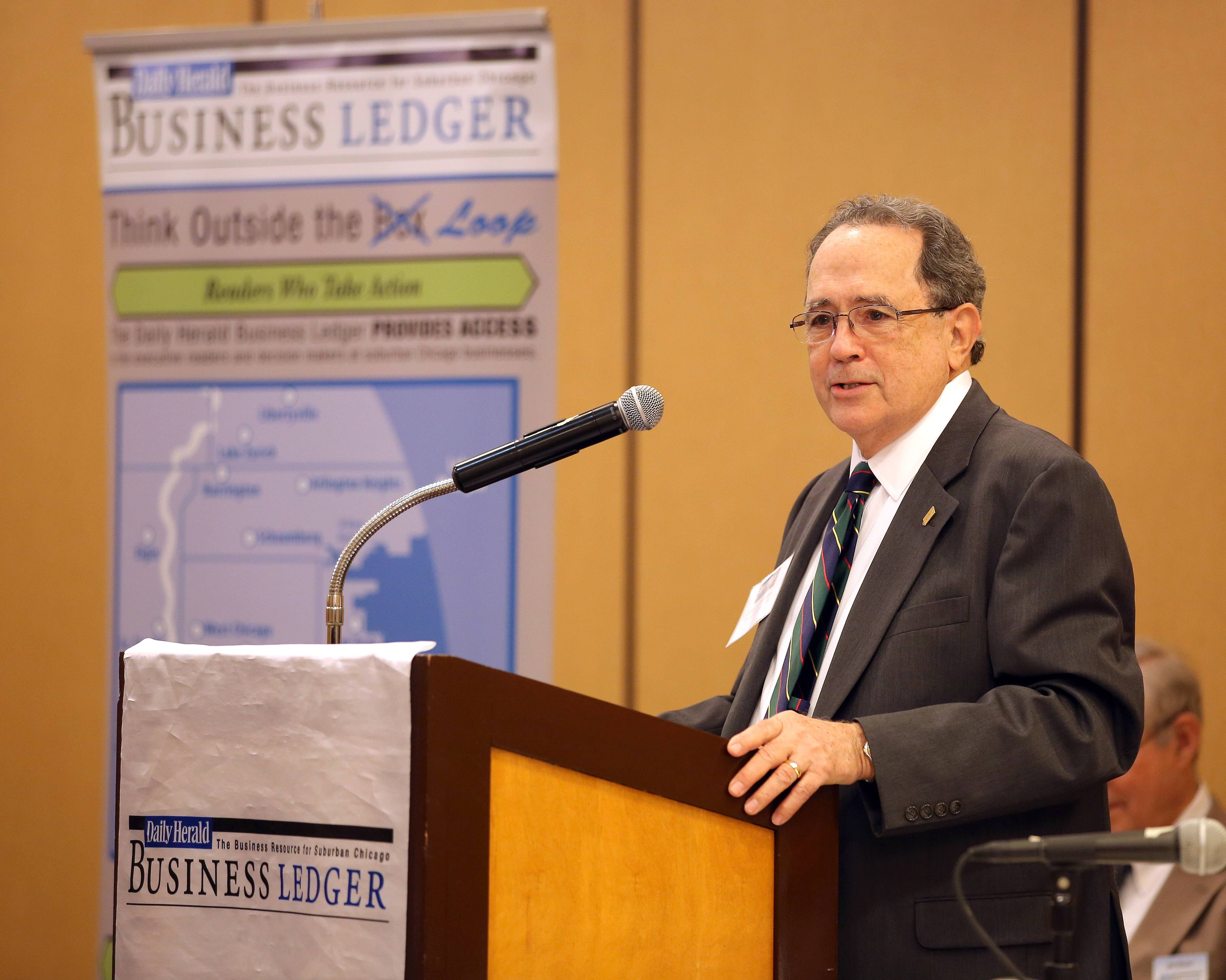 Panelist Trevor Morgan, president of Prairie Business Credit Inc., speaks during the Business Ledger's Newsmakers Forum on banking and finance at the DoubleTree Hotel in Arlington Heights Thursday.