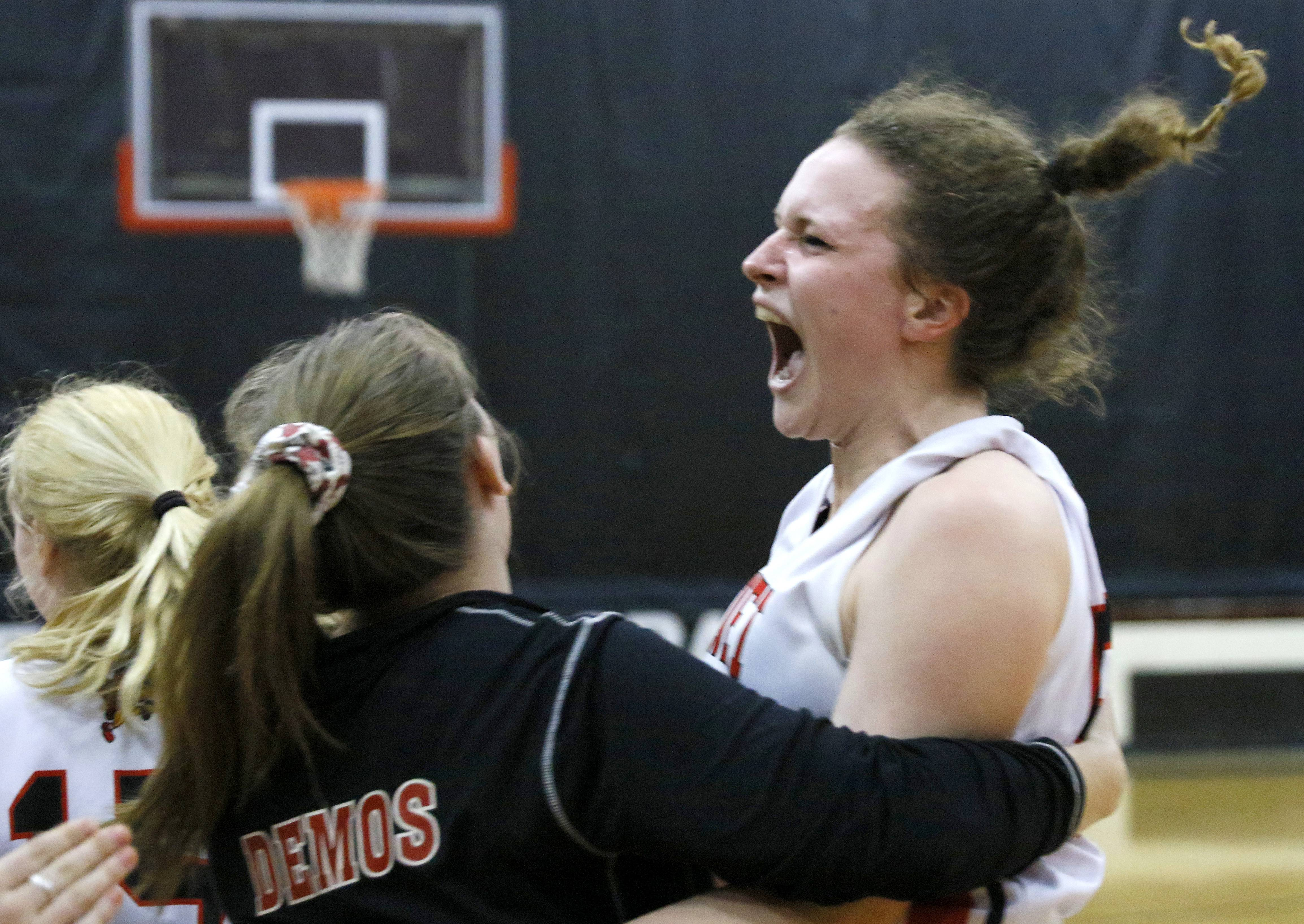 Benet Academy girls basketball players led by Katie Jaseckas, right, celebrate a 59-48 win over Plainfield East to capture the East Aurora sectional championship.