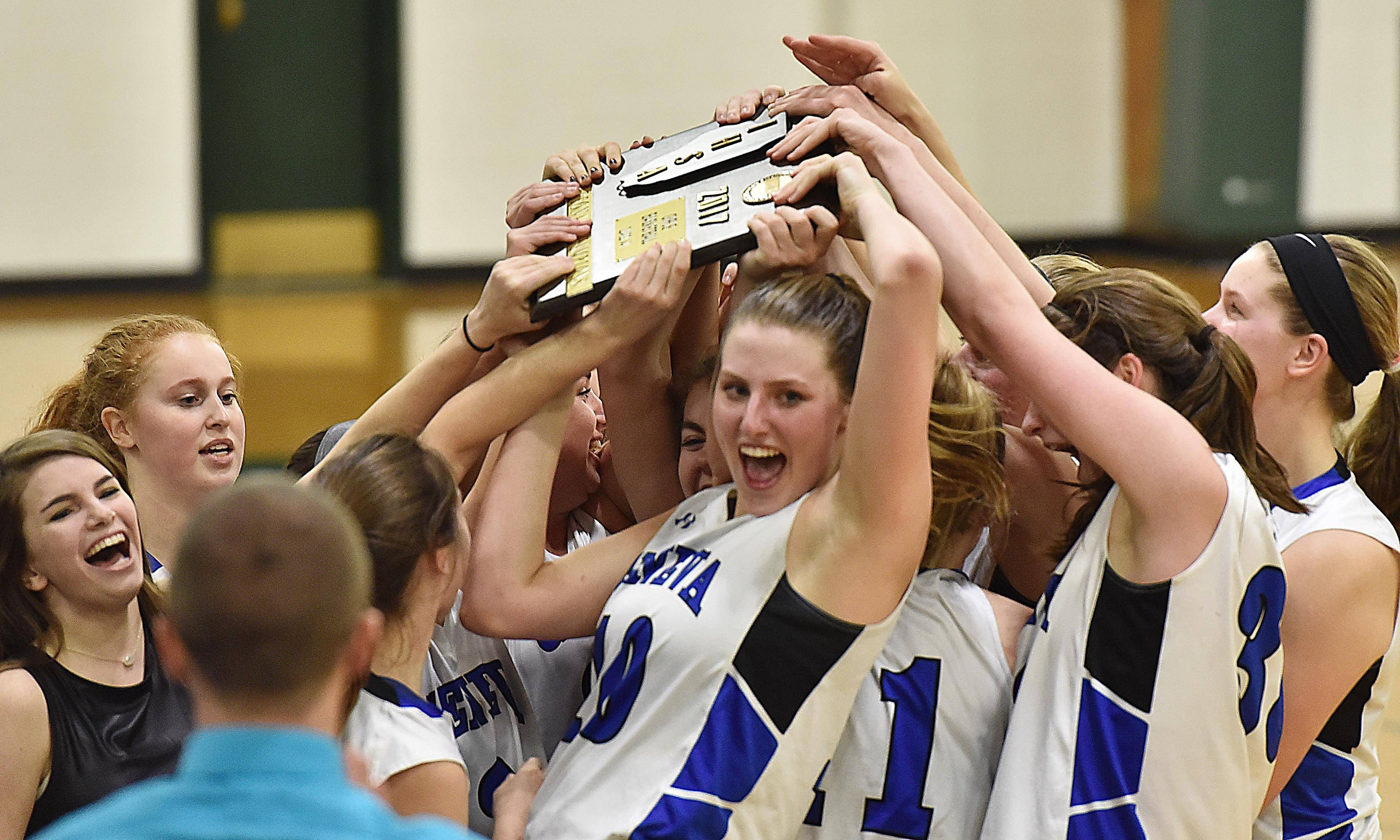 John Starks/jstarks Geneva's Grace Loberg and her teammates hoist the trophy after defeating Rolling Meadows Thursday in the Class 4A Glenbard West sectional girls basketball championship game in Glen Ellyn.