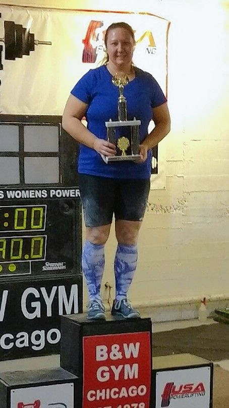 Prospect Heights 1st Ward Alderman Lora Messer accepts a trophy after a powerlifting meet Feb. 12 in Chicago.
