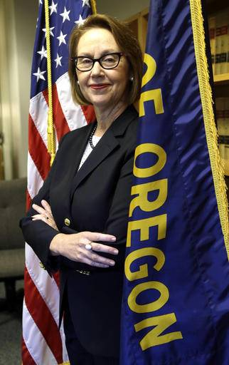 FILE - In this July 13, 2016 file photo, Oregon Attorney General Ellen Rosenblum poses for a photo at her office in Portland, Ore. Rosenblum has staffers strategizing how to fight back if the federal government tries to withhold funds to force compliance with conservative policies, like on abortion. (AP Photo/Don Ryan, file)