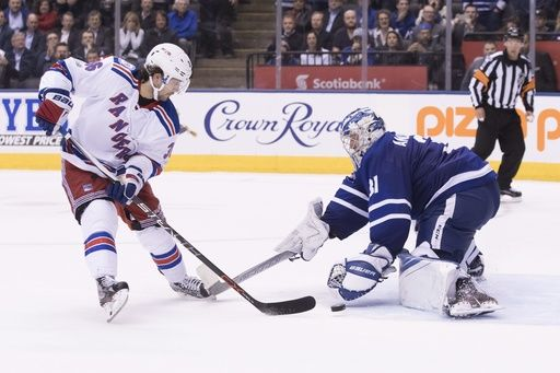New York Rangers right wing Mats Zuccarello (36) scores on Toronto Maple Leafs goalie Frederik Andersen during the shootout in an NHL hockey game, Thursday, Feb. 23, 2017 in Toronto. (Chris Young/The Canadian Press via AP)