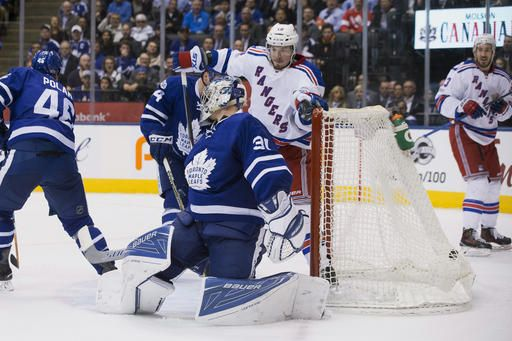 New York Rangers left wing J.T. Miller (10) scores the game-tying goal on Toronto Maple Leafs goalie Frederik Andersen (31) during the third period of an NHL hockey game in Toronto on Thursday, Feb. 23, 2017. New York won, 2-1, in shootout. (Chris Young/The Canadian Press via AP)
