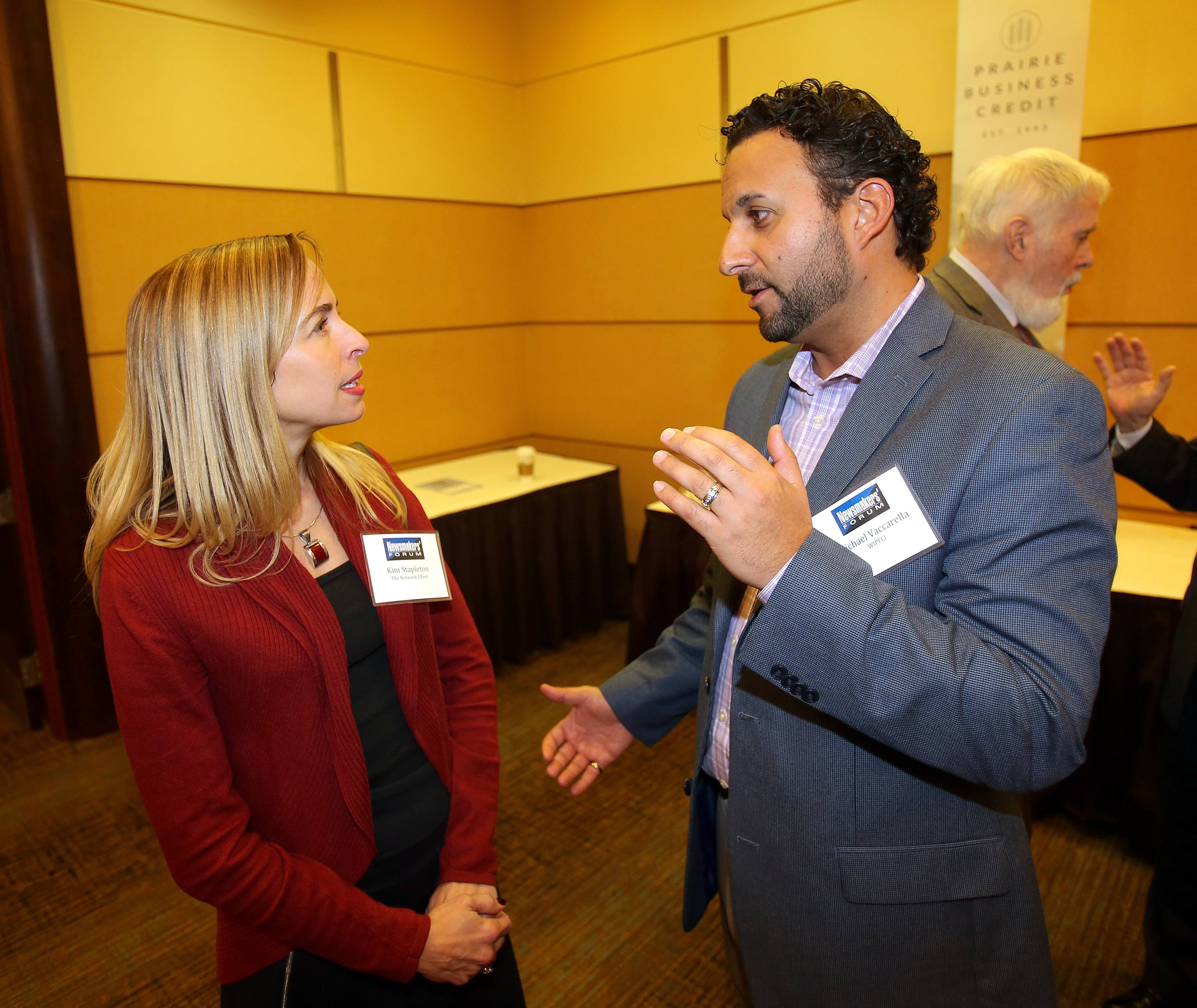 Steve Lundy/slundy@dailyherald.com Kim Stapleton of The Network Effect, left, and Michael Vaccarella of WIPFLI talks during the Business Ledger's Newsmakers Forum on banking and finance at the DoubleTree Hotel in Arlington Heights Thursday.