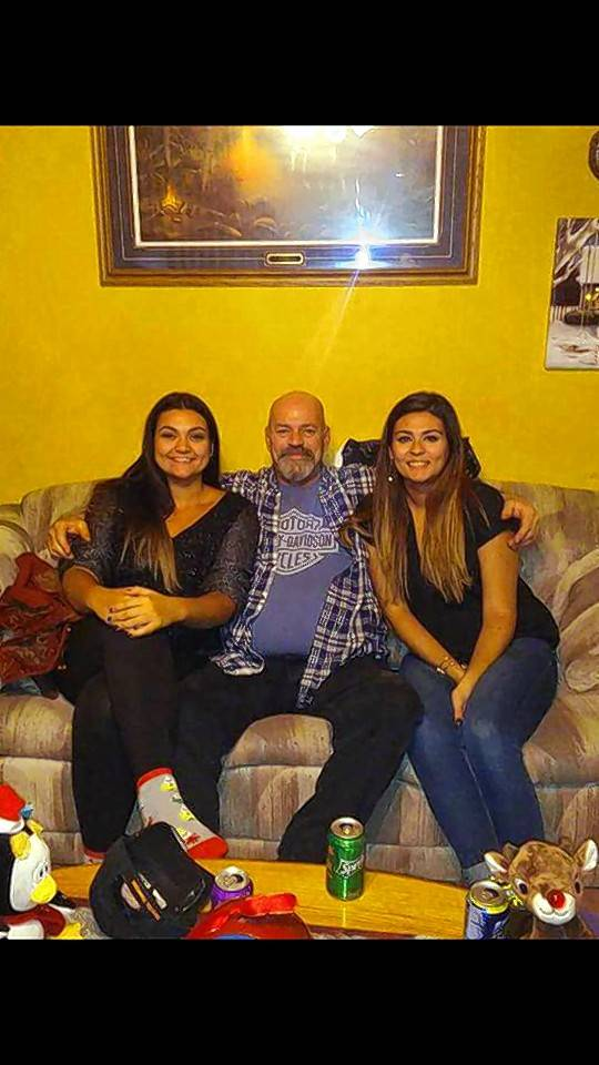John Baske, 57, of Des Plaines, shown here with daughters Nicole and Christina, died Wednesday in a motorcycle crash in Hanover Park.