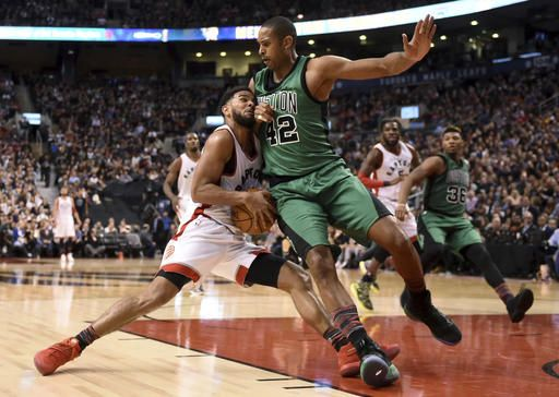Toronto Raptors' P.J. Tucker gets stopped by Boston Celtics' Al Horford (42) during the second half of an NBA basketball game Friday, Feb. 24, 2017, in Toronto. (Frank Gunn/The Canadian Press via AP)