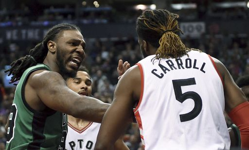 Boston Celtics' Jae Crowder (99) talks to Toronto Raptors' DeMarre Carroll after a foul during the first half of an NBA basketball game Friday, Feb. 24, 2017, in Toronto. (Frank Gunn/The Canadian Press via AP)