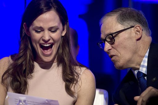 Actress Jennifer Garner and National Governors Association (NGA) Vice Chairman Washington Gov. Jay Inslee look at a document following Garner's address to the NGA's Winter Meeting in Washington, Saturday, Feb. 25, 2017. Garner spoke about the need for early educaiton.