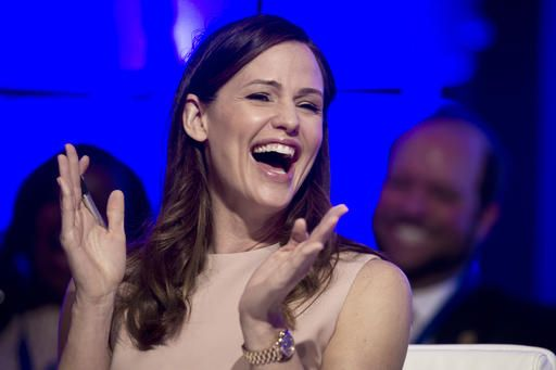 Actress Jennifer Garner reacts to a momentary malfunction of her microphone while addressing the National Governors Association Winter Meeting about early education, in Washington, Saturday, Feb. 25, 2017.