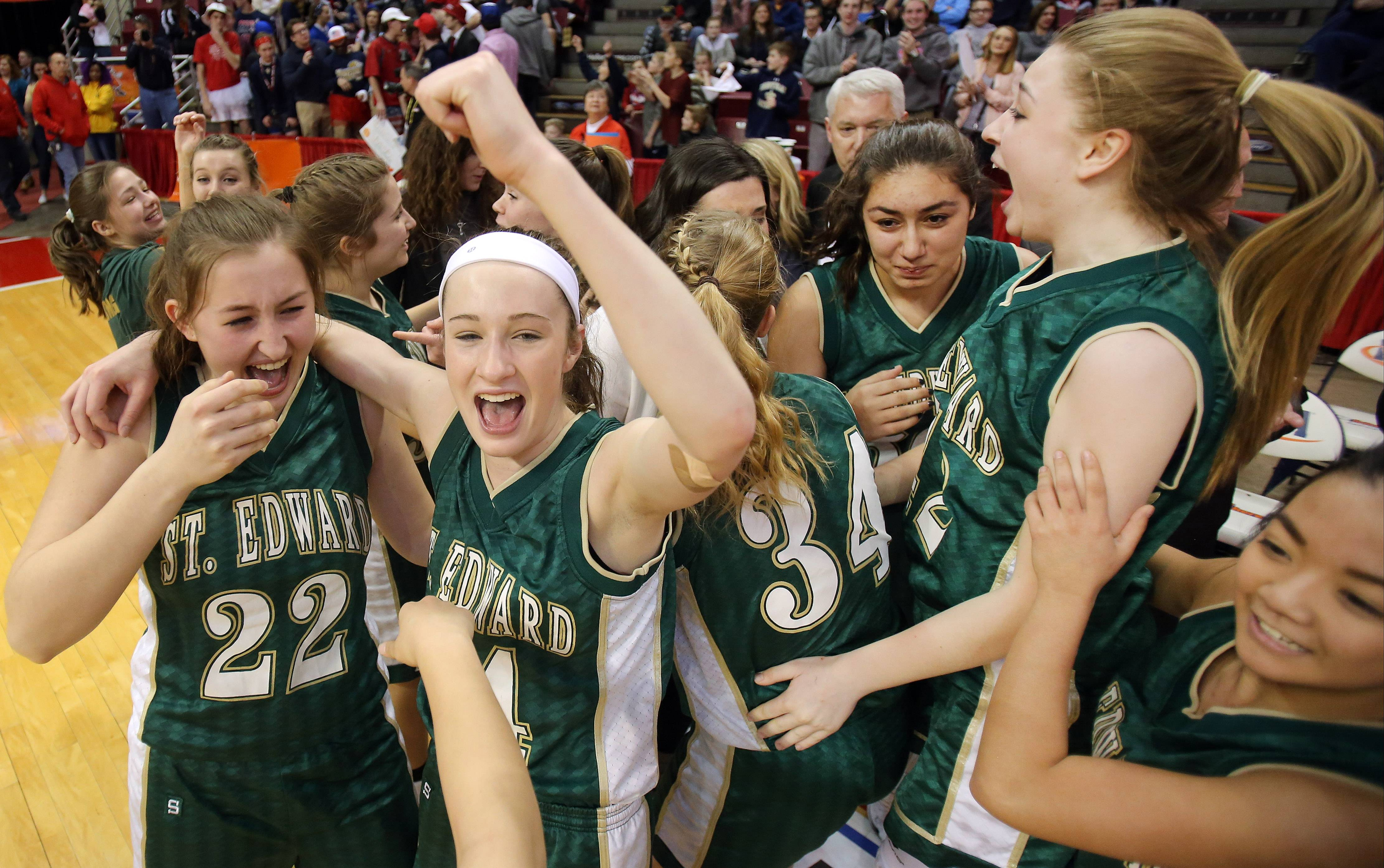 St. Edward's girls celebrate their 47-42 win over Camp Point Central in the Class 2A girls basketball third place state tournament game Saturday in Normal.