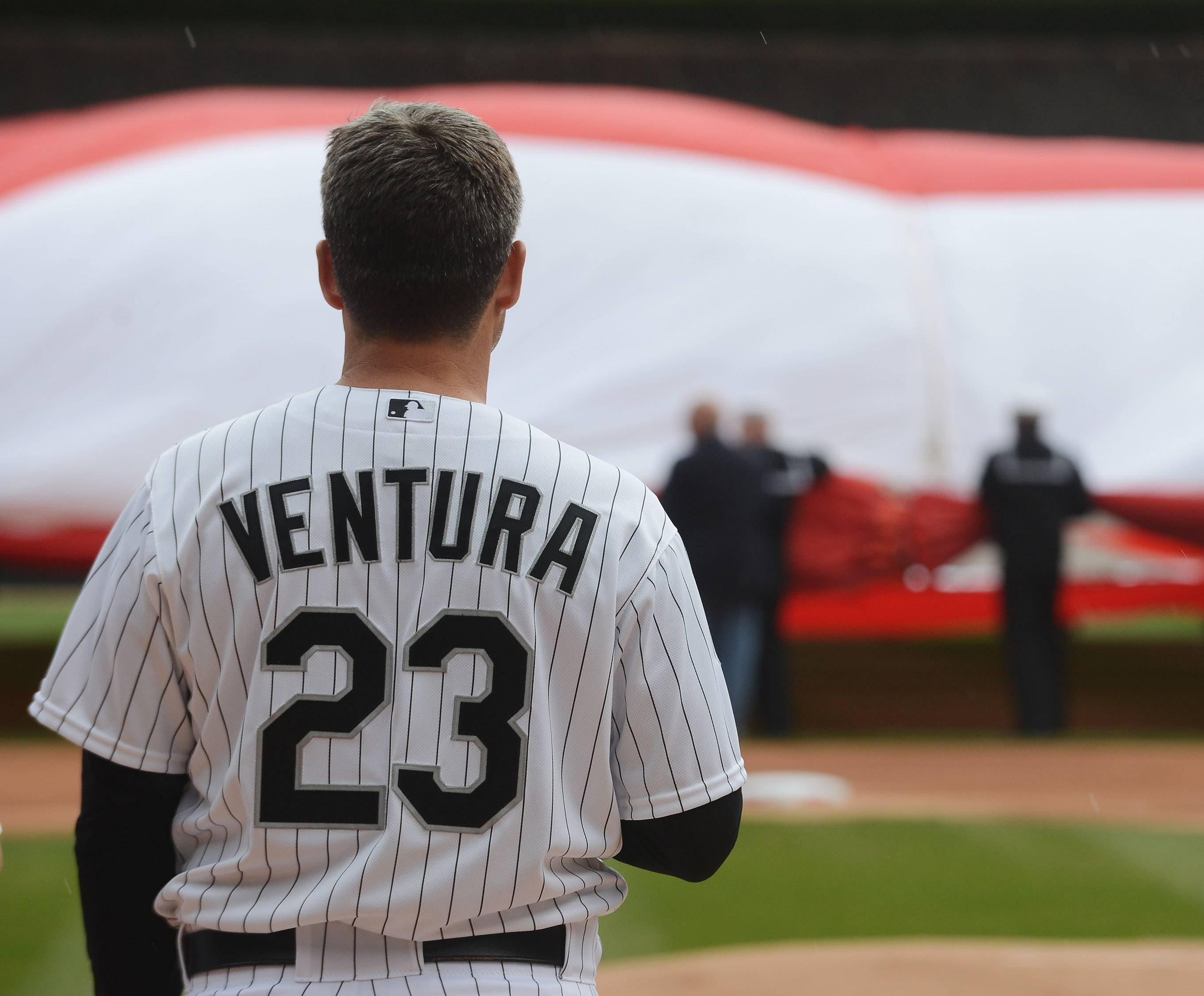Manager Robin Ventura faces the flag on the field during the national anthem at the Chicago White Sox home opener at U.S. Cellular Field in Chicago Friday.