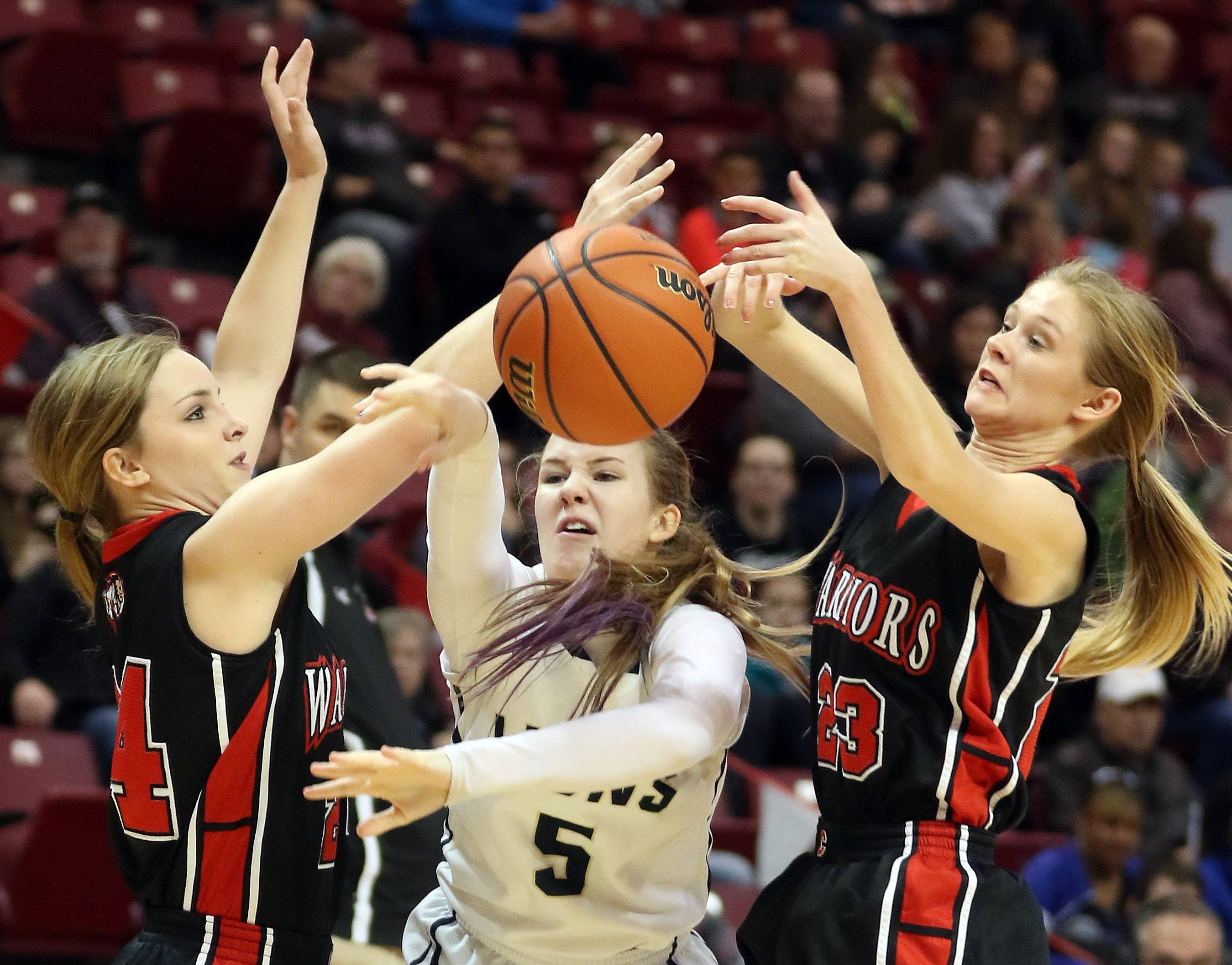 Harvest Christian's Jenn Kasper splits between Hardin's Emily Baalman, left, and Ashleigh Presley during the Class 1A girls basketball third place state tournament game Saturday in Normal.
