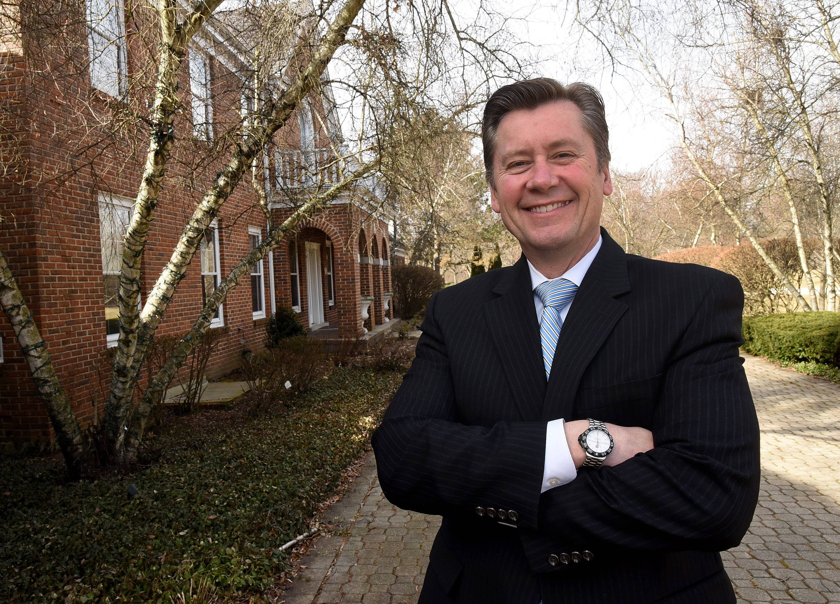 Chris Jacobs, agent with Century 21 - The Pinnacle Group, at one of his listings in Inverness.